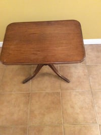 Brown wooden rectangular table