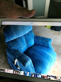 Blue recliner rocker with a tear in the back Goshen, 46526