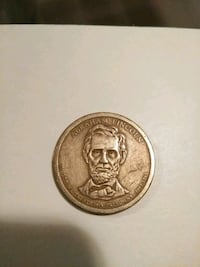 round gold-colored coin Houston, 77063