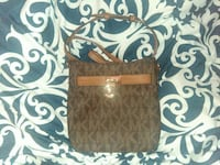 brown and black monogram Coach leather crossbody bag