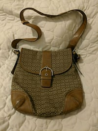 brown and black leather hobo bag Winnipeg, R3T 2P8