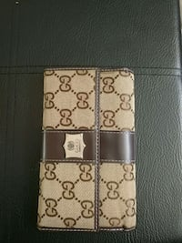 brown and black monogrammed Gucci leather wallet Edmonton, T6K 3M8