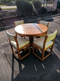 round brown wooden table with four chairs dining set College Park, 20740