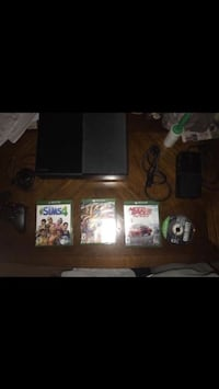black Xbox One console with controller and game cases Harrisburg, 17110