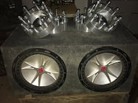 two chrome 5-spoke car wheels with tires