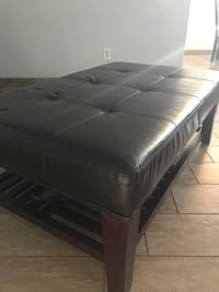 Brown wooden bed frame with black mattress Bakersfield, 93314