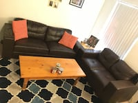 Dark brown couch and love seat Eugene