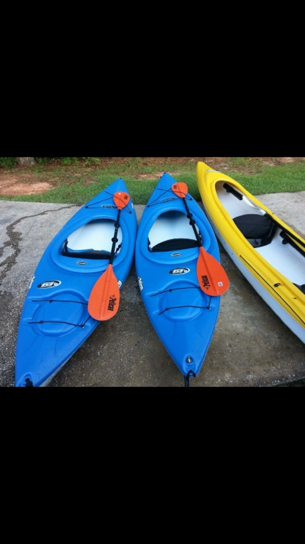 1 large 2 seater yellow pelican brand kayak paddles included and two brand  new blue one seater kayaks