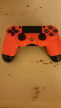 red and black Sony PS4 DualShock 4 151 mi