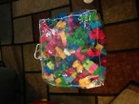 assorted color building blocks in clear bag