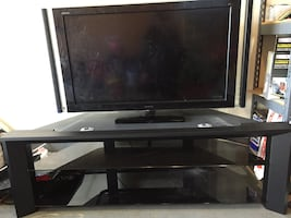 Free - 55 inch Sony Bravia with solid tv stand #broken. C description