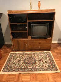 Brown wooden tv hutch with television Laval, H7G
