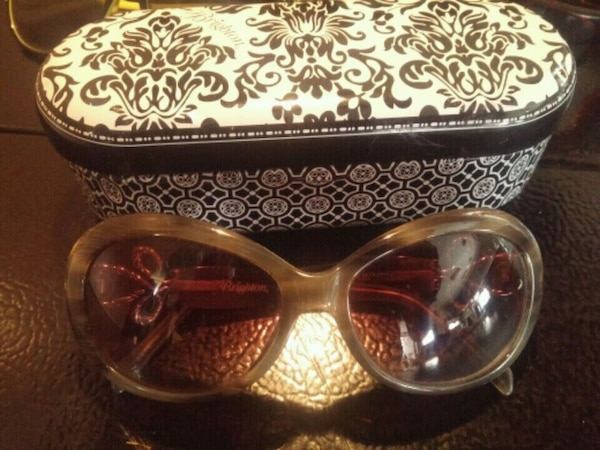 brown framed sunglasses with case