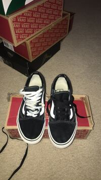 pair of black-and-white sneakers Youngsville, 27596