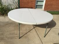 (2 available) 60 inches  round plastic table with folding legs.