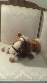 brown and white horse plush toy