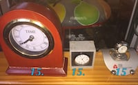 two red and grey mantel clocks Montréal, H2A 3A7