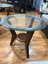 round glass-top table with black wooden base Toronto, M9V