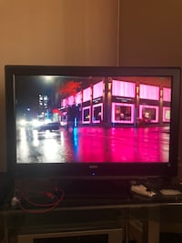 Black flat screen tv with remote 2238 mi
