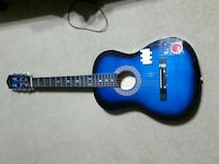 black and blue wooden classical guitar Dunnellon, 34432
