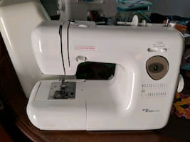 Sewing machine with cover