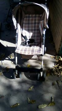 baby's black and brown plaid stroller