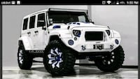white and black Jeep Wrangler Upper Marlboro, 20774