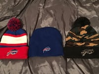 Three assorted-color-and-pattern buffalo bills knit caps