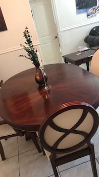 Brown wooden dining table set Miami, 33145