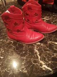 pair of red leather cowboy boots