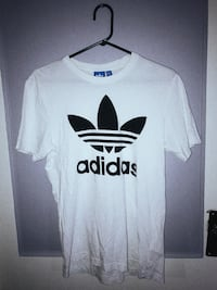 white and black Adidas crew-neck t-shirt