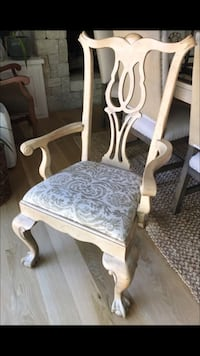 Brown wooden framed white and gray padded armchair Oklahoma City, 73112
