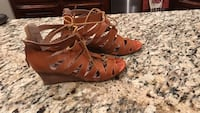 pair of brown leather wedge gladiator sandals Weatherford, 73096