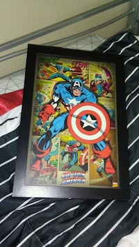 black wooden framed Captain America comic poster