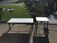 Set of 2 coffee tables refinished black/white.  Rod iron base is black.  Wood table top is painted white Fusion paint Delivery available. $70. For the set. St Catharines, L2P 3L2