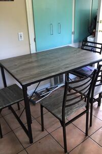 Brand new table and chairs just assembled for sale!!  New Westminster, V3L 2M4