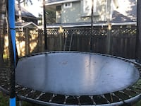 gray and black trampoline with enclosure Surrey, V3W 8H7