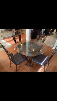 All 3 pieces are included in price. Glass table with 4 chairs, foyer table & coffee table. Walker, 70785