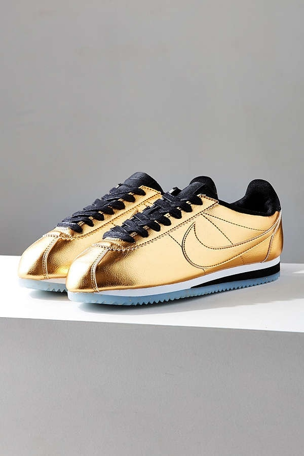 wholesale dealer a88d3 0b482 White-and-gold-colored Cortez Nike low-top sneakers