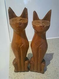 two brown wooden cat figurines 3745 km