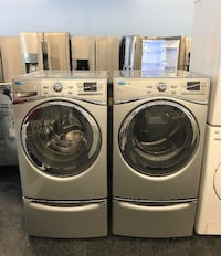 two white front-load clothes washer and dryer set