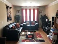 Black leather sofa/couch, curtains, vase, pictures, rug 30 km