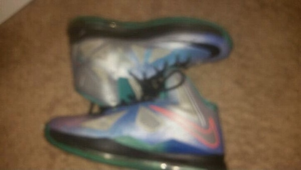 pair of blue-and-green Nike basketball shoes