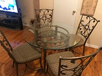 Glass table with 4 cushion wrought iron chairs  Fort Lee, 07024