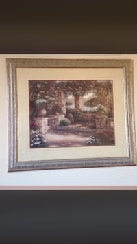 painting of grey concrete brick wall near plants with grey frame