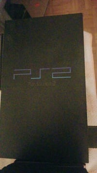 PS2 with two controllers, 8gb memory card and 14 games!!