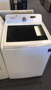 white Samsung top-load clothes washer
