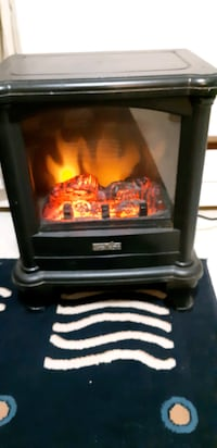Cozy compact faux fireplace/space heater