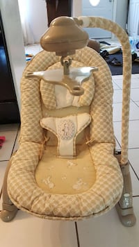 baby's brown Summer cradle and swing