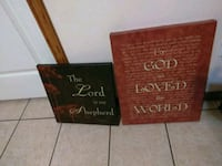 two brown and black quote canvas